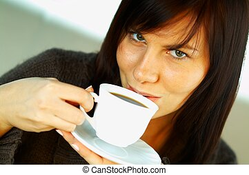 Just a coffee cup - Brunnete woman with a white cup of black...