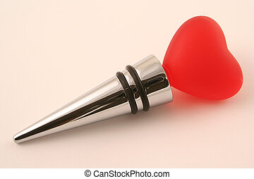 heart stopper - a chrome wine stopper decorated with a red...