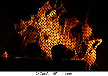 Fireplace Warmth - Flames burn furiously behind the...