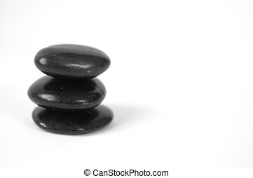 stacking tall - three massage rocks in a stack