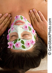 Nature Mask and Massage - A woman enjoys a salon mask and...