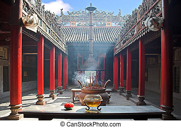 Smoke-filled temple - Temple filled with smoke from burning...