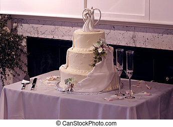 Beautiful Multi-Tier Wedding Cake and Champagne Glasses -...
