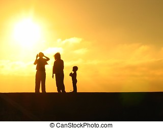 Fun in the Sun - -- a young family enjoying a day at the...