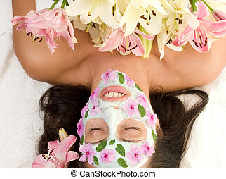 Spa Beauty - Beutiful woman relaxing in a botanical mask...