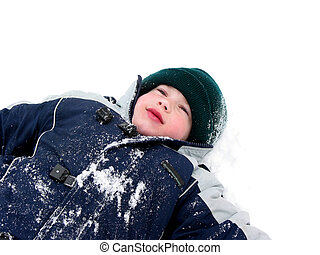 Boy child winter fun - Young boy lying in snow enjoying...