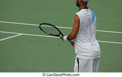 Tennis Player - A tennis player in a competition
