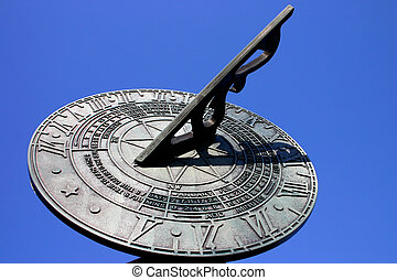 Sundial against blue - Sundial against pure blue summer sky