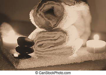 Spa supplies - Towels, hot rocks and candles for a spa day