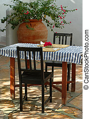 Breakfast Table - An inviting greek style courtyard...