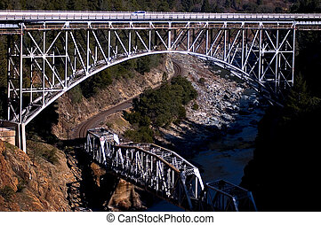 criss cross bridges - train and car bridge over lapping the...