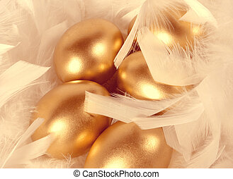 Gold eggs - gold golden eggs in feathers