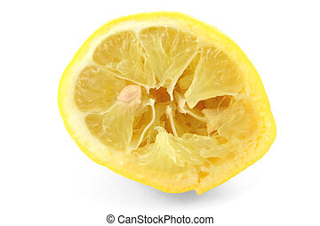 squeezed out lemon on white