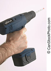 tool time VI - hand holding a drilling tool - Hand mit einer...