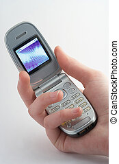 mobile - Handy - cell phone with shiny display in a girls...