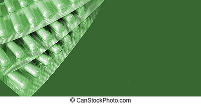 Capsules, green hue - Pack of capsules isolated with space...