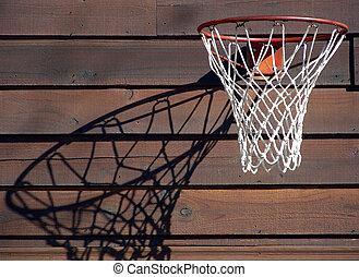 Hoop Dreams - Basketball hoop with late afternoon shadow