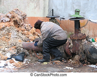 homeless warms up near the hot-water system