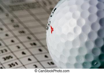 Golf Ball - Close-up of a golf ball on a scorecard (shallow...