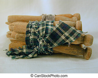 clothes pins - Old wooden clothes pins tied with fabric.