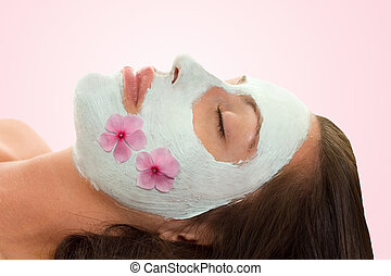 Beautify - A woman with botanical facial treatment