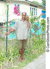 island man with radio 751 - barefoot island man listening to...