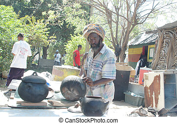 rasta man preparing food 320 - rasta preparing food at...
