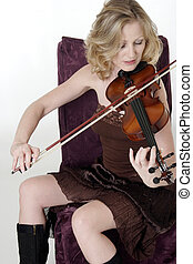 Pretty woman sittin playing the violin