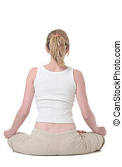 Back of woman doing yoga exercise on white background