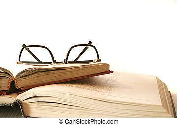 stack of books - books stacked with reading glasses
