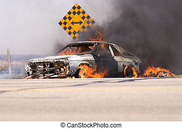 Blazing car fire - Care in flames on the side of the road