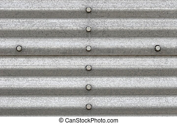 metal background with bolts - closeup of building siding