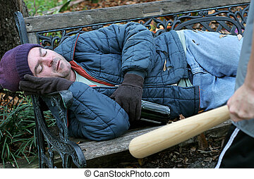 Homeless Man - Defenseless - A homeless man sleeping while a...