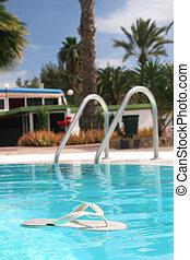 Floating Flip Flop - Flip flop floating in pool
