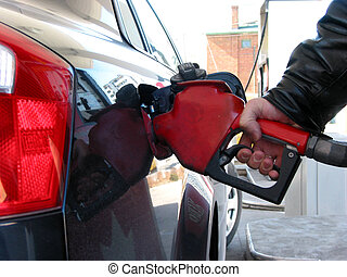 Gas pump fueling - Car being filled up with gas at gas pump