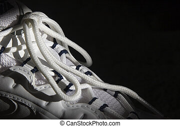 Laces on running shoes - Laces on running shoe on black...