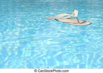 Floating Flip Flop - White flip flop floating in blue pool