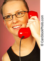 Women with red phone - Pretty blonde young women with red...