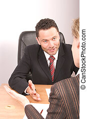 negotiations - White business man and woman talking