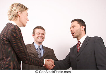 business handshake 3 - Group of 3 busisness people - man and...