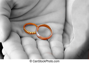 wedding bands - man holding wedding bands