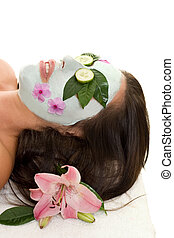 Cucumber and Green Tea Mask - A woman with green tea and...