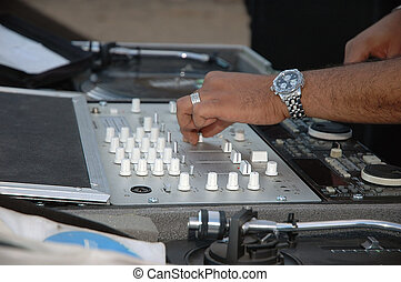 DJ table - DJ controlling the sound