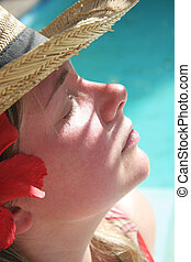 Sunny Face - Woman in the shade by pool