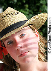 Palm Shadow Face - Woman in hat with palm frond shadow