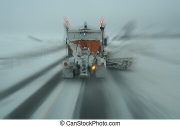 Plowing - Motion blurred snow removal truck in canada