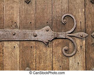 Ancient door detail - Ancient wooden brown door detail with...
