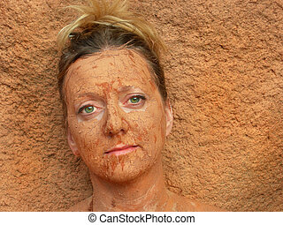 Mud Blend - Woman with facial mud blends into background