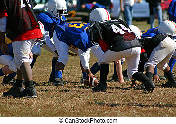 football 3 - Children playing peewee football at local park