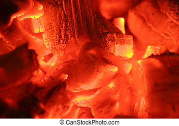 close up of glowing hot embers in the middle of a fire